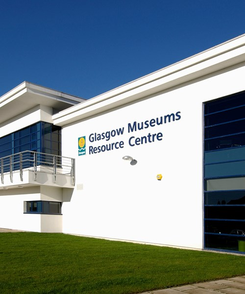 Exterior of Glasgow Museums Resource Centre. The centre is a large, white building with big glass windows.